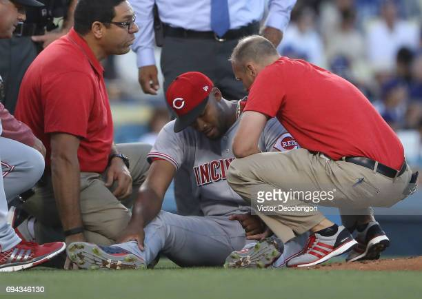 Cincinnati Reds trainers check the hand of pitcher Amir Garrett of the Cincinnati Reds after getting hit by the ball in the second inning during the...