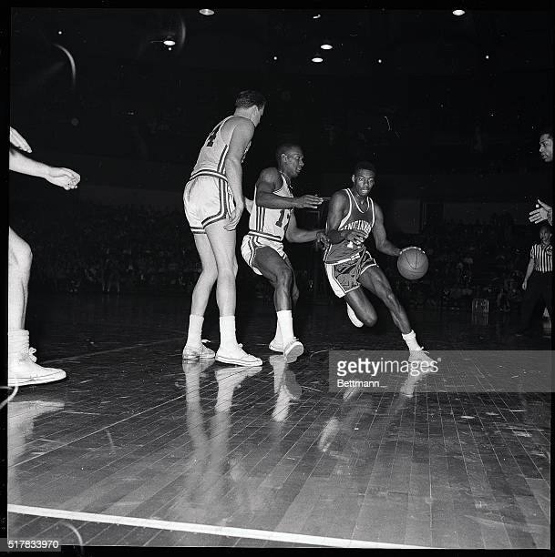 Cincinnati's 'Big O' Oscar Robertson rushed around the Hawk's Si Green in the 2/11 afternoon game here Robertson successfully got by Green and...