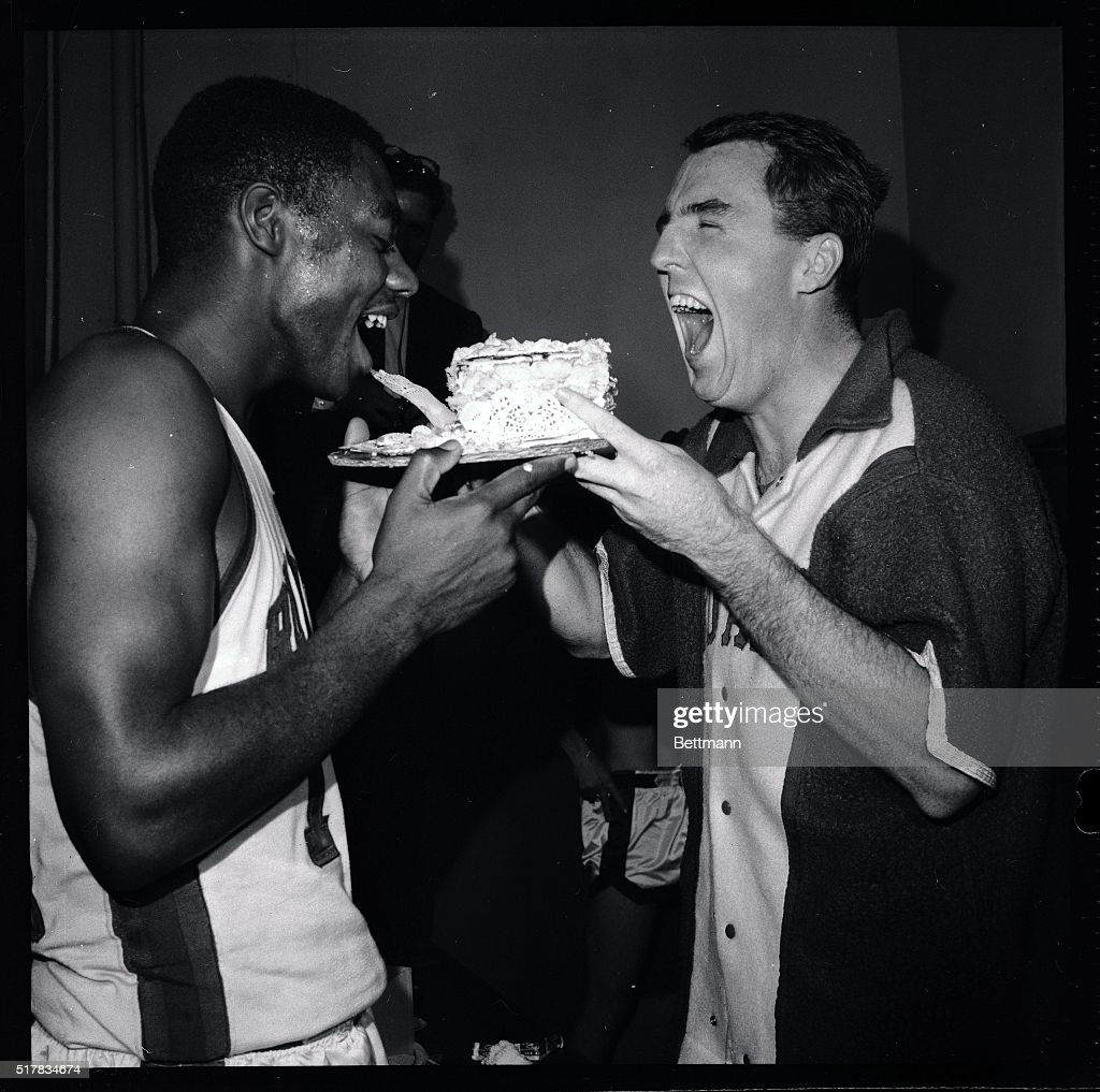 Oscar Robertson and Teammate Eating Cake