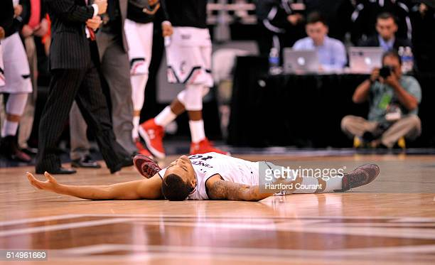 Cincinnati's Troy Caupain looks exhausted after the first of four overtime periods against Connecticut in an AAC Tournament quarterfinal at the Amway...