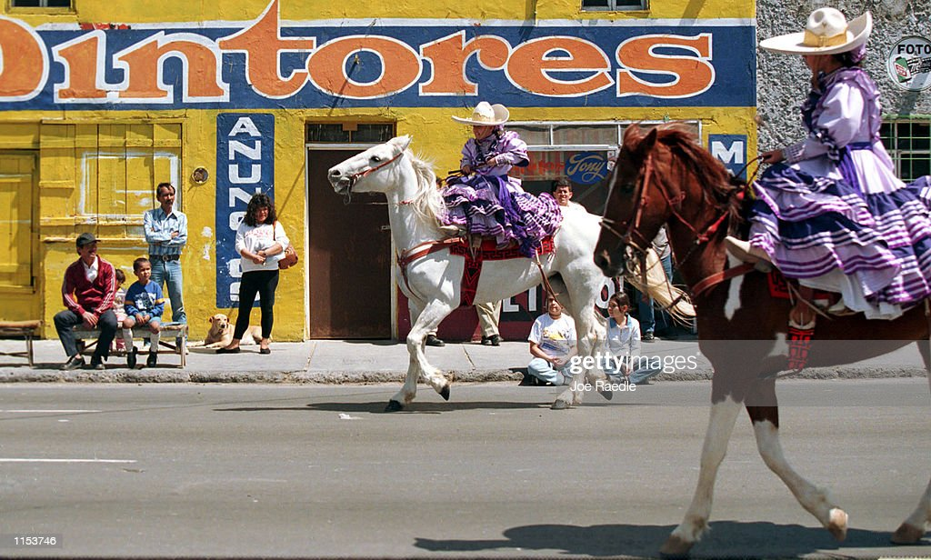 Cinco de Mayo festivities take place in Ciudad Jaurez Mexico May 5 1999 Residents celebrate with military bands music horses and traditional costumes...