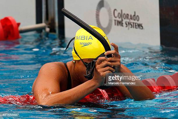 Cincy Mejia of Colombia reacts after competes in 100 mts Finswimming event as part of the XVII Bolivarian Games Trujillo 2013 at pools complex of...