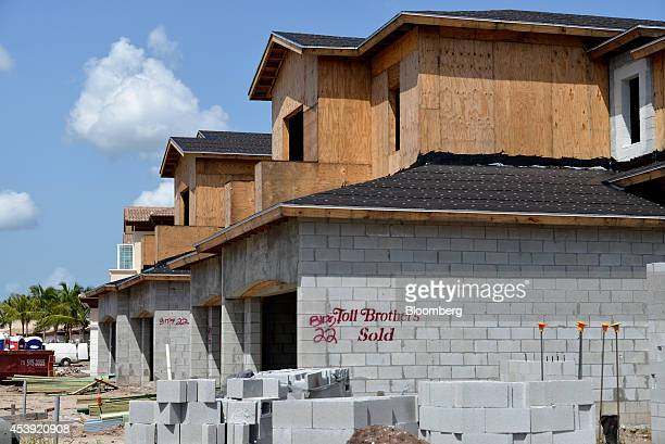 Cinder blocks sit in a pile near homes under construction at the Toll Brothers Inc Jupiter Country Club housing development in Jupiter Florida US on...