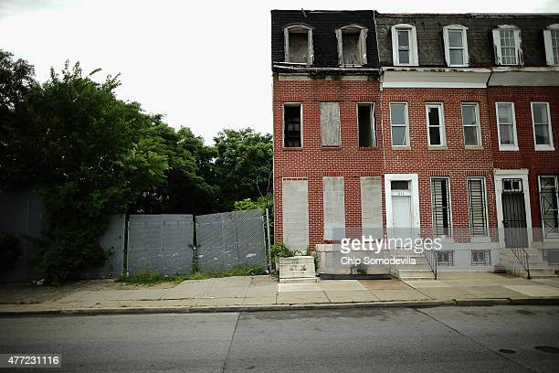 Cinderblocks wall off the door and windows of a burned and abandoned rowhouse across the street from First Mt Calvary Baptist Church where US Sen...