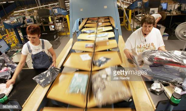 Cindy Amsden and Joan Drouin place clothing orders on a conveyor belt in the LL Bean shipping center on 'Cyber Monday' the online retail world's...
