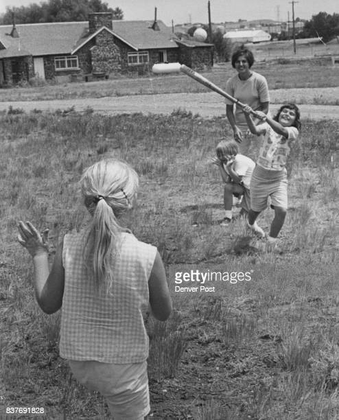 Cindy Bender 734 Owens St Lakewood gets a hit Pitcher is Jo Ann Hilton of 591 S Simms St Green Mountain and catcher is Lisa Schneider of 8793 W 46th...
