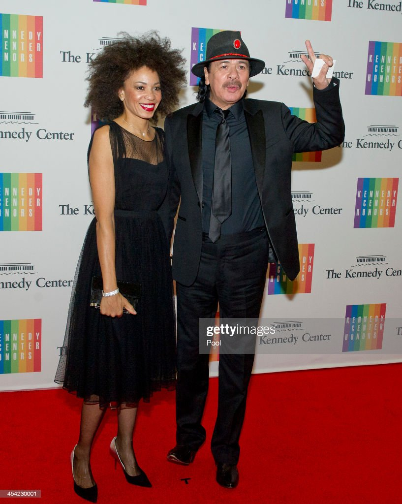 Cindy Blackman and Carlos Santana arrive at the formal Artist's Dinner honoring the recipients of the 2013 Kennedy Center Honors hosted by United States Secretary of State John F. Kerry at the U.S. Department of State on December 7, 2013 in Washington, D.C. The 2013 honorees are: opera singer Martina Arroyo, musician/composer Herbie Hancock, singer/songwriter Billy Joel, actress Shirley MacLaine, and musician/songwriter Carlos Santana.