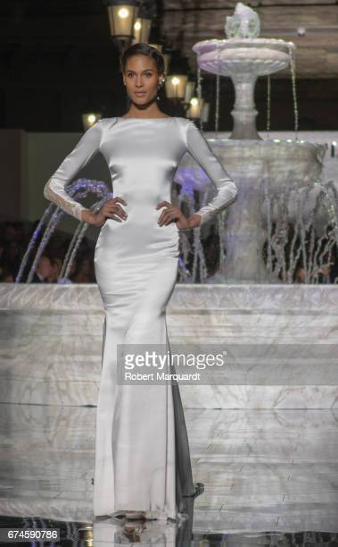 Cindy Bruna walks the runway for the Pronovias Show during Barcelona Bridal Fashion Week 2017 held at the Museu Nacional d'Art de Catalunya on April...