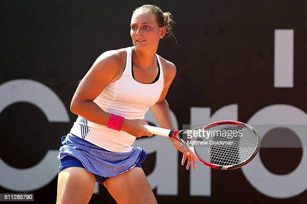 Cindy Burger of Netherlands returns a shot to Francesca Schiavone of Italy during the Rio Open at Jockey Club Brasileiro on February 19 2016 in Rio...