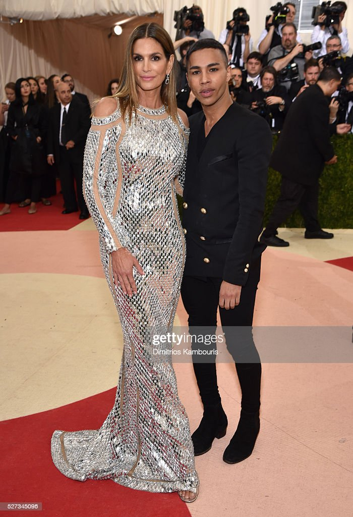 Cindy Crawford (L) and designer Olivier Rousteing attend the 'Manus x Machina: Fashion In An Age Of Technology' Costume Institute Gala at Metropolitan Museum of Art on May 2, 2016 in New York City.