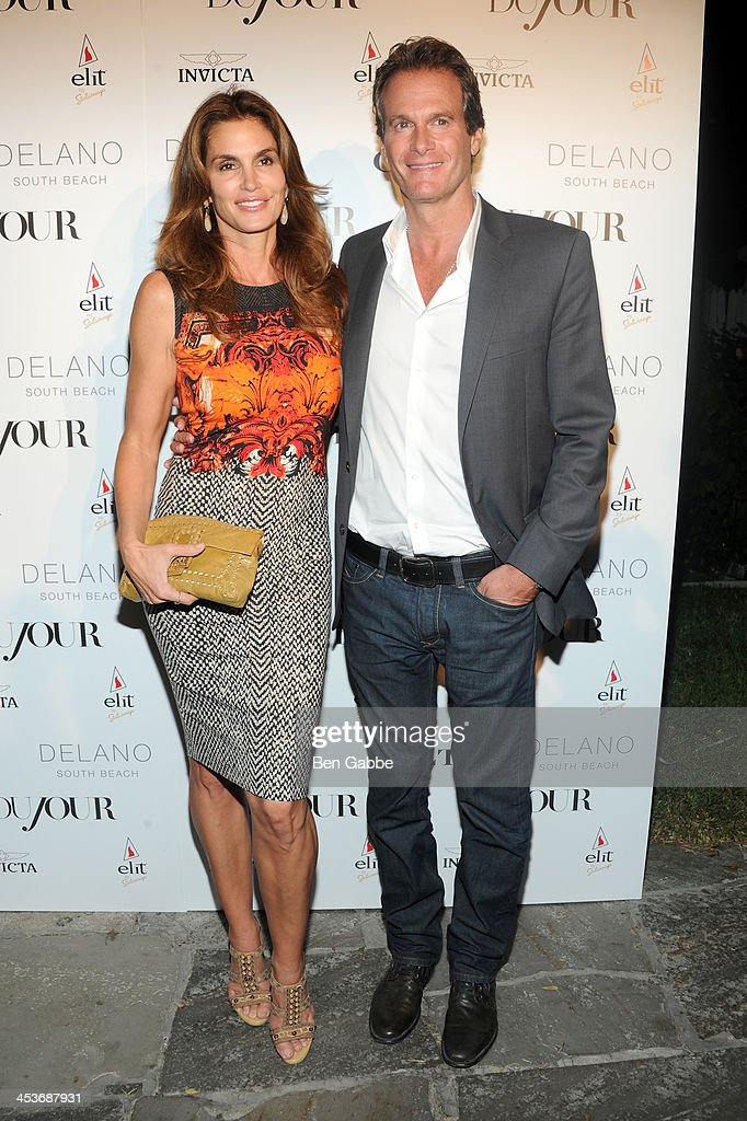 Cindy Crawford (L) and Rande Gerber attend DuJour Magazine's event to honor artist Marc Quinn at Delano South Beach Club on December 4, 2013 in Miami Beach, Florida.