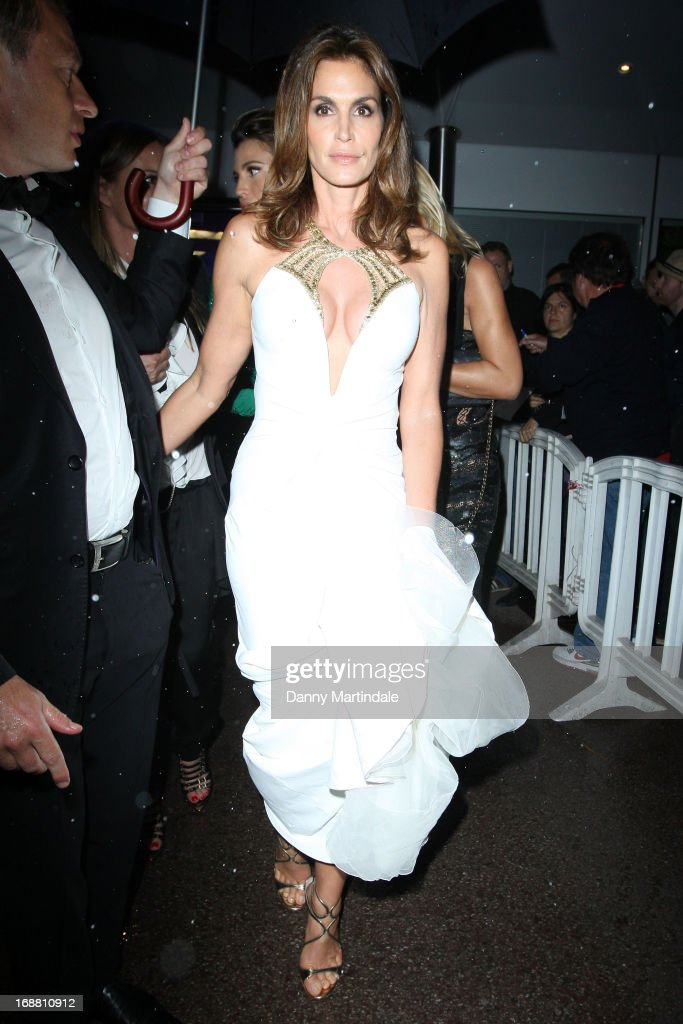 Cindy Crawford departs the Opening Ceremony and premiere of 'The Great Gatsby' during the 66th Annual Cannes Film Festival at Palais des Festivals on May 15, 2013 in Cannes, France.