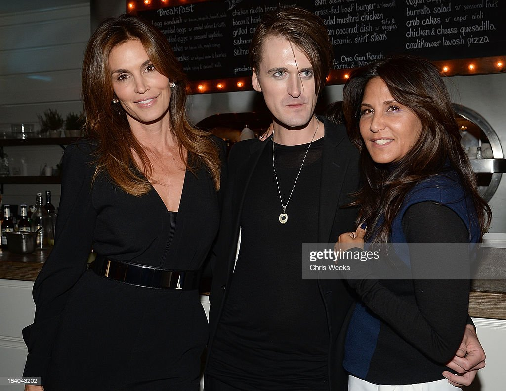 Cindy Crawford, fashion designer Gareth Pugh and Laurie Lynn Stark attend a dinner for Gareth Pugh hosted by Chrome Hearts at Malibu Farm on October 10, 2013 in Malibu, California.