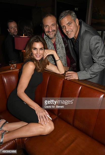 Cindy Crawford Joel Silver and George Clooney attend the London launch of Casamigos Tequila and Cindy Crawford's book 'Becoming' hosted by Rande...