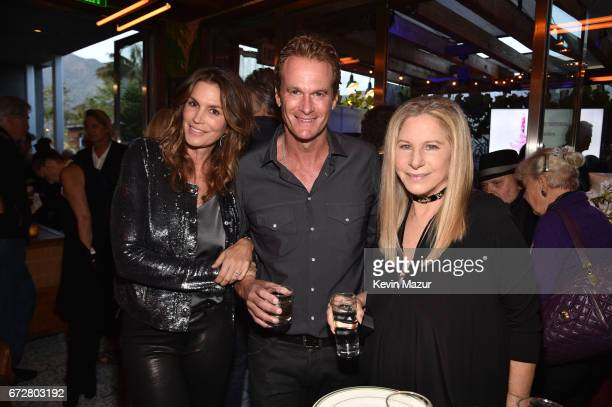 Cindy Crawford Rande Gerber and Barbra Streisand attend Barbra Streisand's 75th birthday at Cafe Habana on April 24 2017 in Malibu California