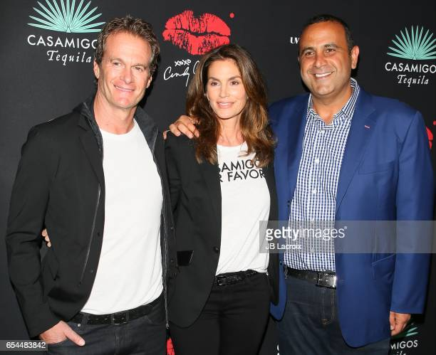 Cindy Crawford Rande Gerber and Sam Nazarian attend the Umami Burger x Cindy Crawford Artist Series Launch on March 16 2017 in Beverly Hills...