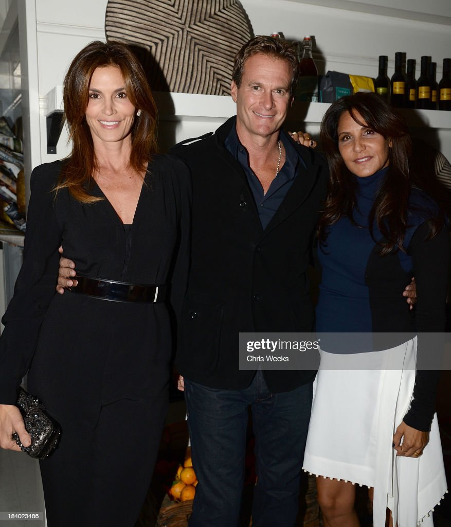 Cindy Crawford, Randy Gerber and Laurie Lynn Stark attend a dinner for Gareth Pugh hosted by Chrome Hearts at Malibu Farm on October 10, 2013 in Malibu, California.