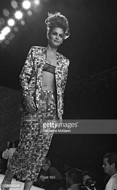 Cindy Crawford walks the runway at a Todd Oldham fashion show on October 31 1995 in New York City New York