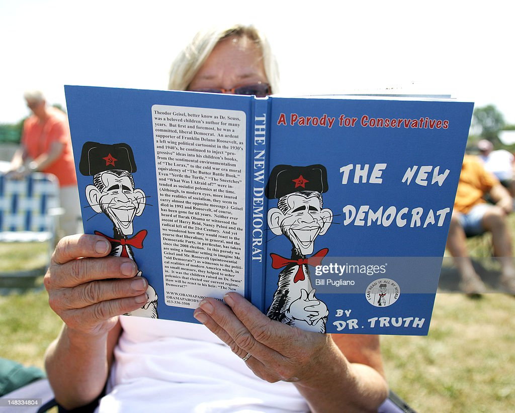 Cindy Fischhaber of Chelsea, Michigan reads a book while waiting to hear Sarah Palin speak at the Wayne County Fairgrounds July 14, 2012 in Belleville, Michigan. The ''Patrioys in the Park'' Tea Party event was sponsored by Americans for Prosperity: Michigan and the Willow Run Tea Party Caucus.