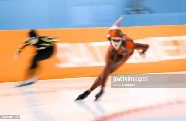 Cindy Klassen of Canada skates against Maki Tabata of Japan during the Women's 1000 meter speed skating event of the 2002 Olympic Games on February...