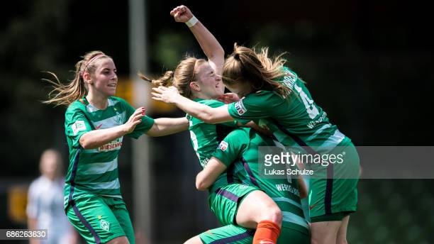 Cindy Koenig and team mates celebrate their teams first goal of Verena Volkmer during the Second Bundesliga Nord match between Werder Bremen and VfL...