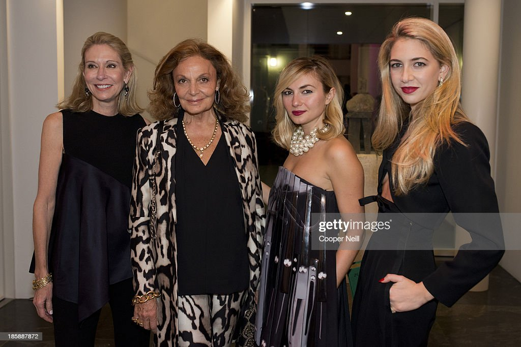 Cindy Rachofsky, Diane von Furstenberg, Nasiba Adilova and Sabine Ghanem pose for a photo during the Young Collectors Two x Two Cocktail party at the Rachofsky House on October 25, 2013 in Dallas, Texas.