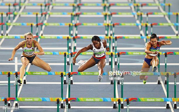 Cindy Roleder of Germany Tiffany Porter of Great Britain and Andrea Ivancevic of Croatia compete in the Women's 100m Hurdles Semifinals on Day 12 of...