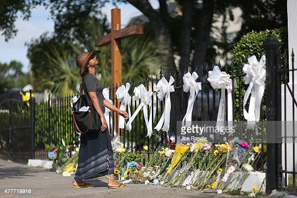 Cindy Samaroo pays her respects in front of the Emanuel African Methodist Episcopal Church after a mass shooting at the church that killed nine...