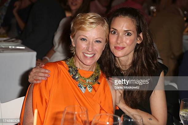 Cindy Sherman and Winona Ryder attend The 20th Annual Watermill Center Summer Benefit at The Watermill Center on July 27 2013 in Water Mill New York