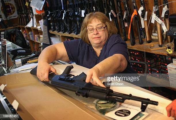 Cindy Sparr boxes up an AK47 style rifle after selling it at Freddie Bear Sports sporting goods store on December 17 2012 in Tinley Park Illinois...