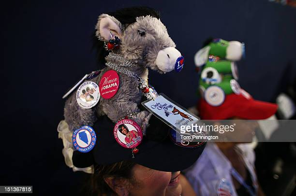 Cindy Trigg wears a hat decorated with a plush donkey and campaign buttons during the final day of the Democratic National Convention at Time Warner...