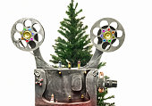 Movie projector and new years tree on a white background