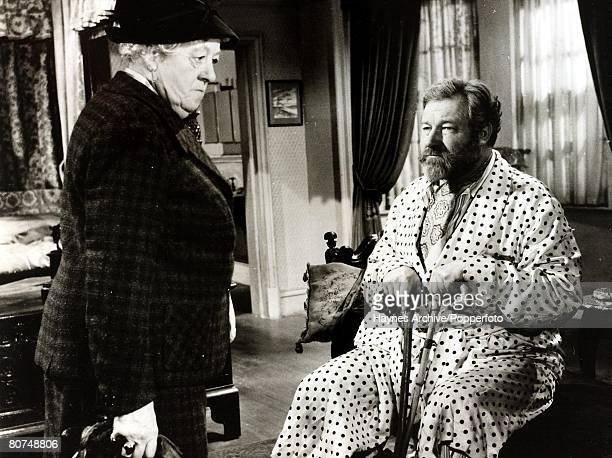 Cinema British film actors Margaret Rutherford and James Robertson Justice in a still from the film Murder She Said'