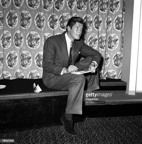 Cinema London England British actor Roger Moore is pictured signing autographs at a press reception at MGM Metro House