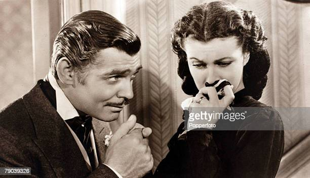 Cinema Personalities American actor Clark Gable playing opposite English actress Vivien Leigh in the 1939 classic film 'Gone With The Wind'