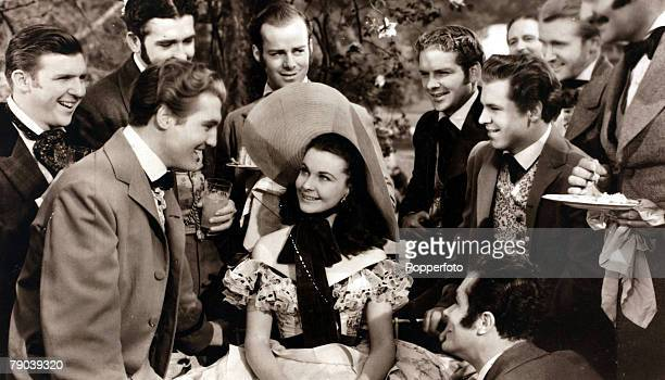 Cinema Personalities English actress Vivien Leigh in the 1939 classic film 'Gone With The Wind' surrounded by a group of male admirers