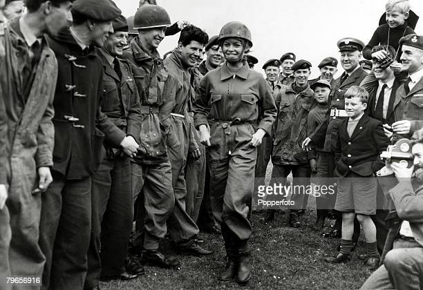 11th April 1959 French actress Brigitte Bardot training for a parachute jump in a role for her film 'Babette Goes To War' is pictured amongst a group...