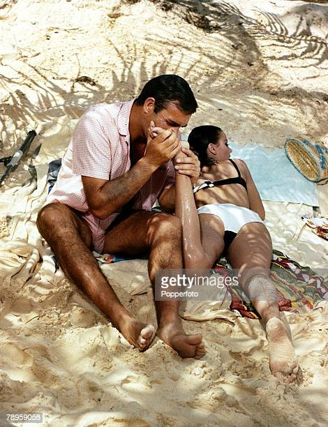 1960's Sean Connery playing a typical scene as '007' in a James Bond film
