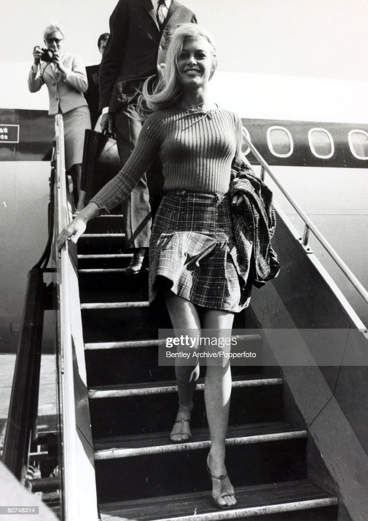 2nd September 1966, French actress <a gi-track='captionPersonalityLinkClicked' href=/galleries/search?phrase=Brigitte+Bardot&family=editorial&specificpeople=202903 ng-click='$event.stopPropagation()'>Brigitte Bardot</a>, (born 1934), arrives a London Airport dressed in a mini-skirt, <a gi-track='captionPersonalityLinkClicked' href=/galleries/search?phrase=Brigitte+Bardot&family=editorial&specificpeople=202903 ng-click='$event.stopPropagation()'>Brigitte Bardot</a>, first appeared on screen in 1952, married Roger Vadim when she was 18 and became a major star after appearing in Director Vadim's 1956 film 'And God Created Woman', She became a blond international sex symbol and sex kitten appearing in many French productions, later in the 1960's becoming popular in the USA, She retired from films in the 1970's and has devoted much time to animal rights causes, while now living a reclusive lifestyle