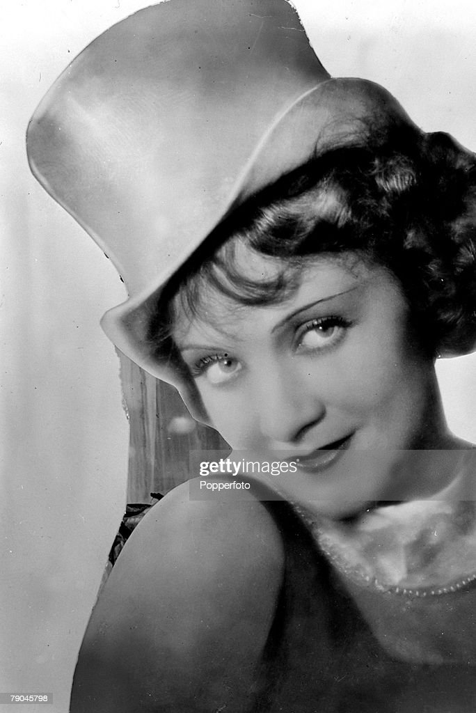 circa 1930's, Marlene Dietrich, (1901-1992) right, pictured in one of her Hollywood films, A German born actress who first won fame in the film 'The Blue Angel' in 1930, she went to Hollywood and became a U,S,citizen in 1937, She had a husky sultry singing voice which added to her appeal