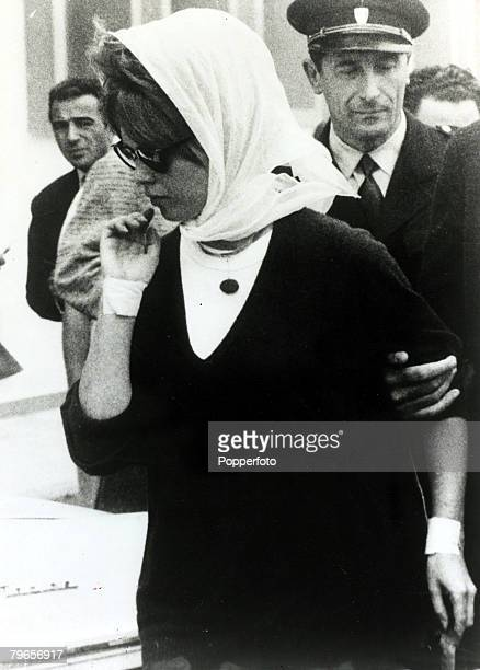 October 1960 French actress Brigitte Bardot pictured with her wrists lightly bandaged as she leaves a Nice clinic where she had been recovering after...