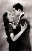 Cinema Personalities Swedish born film actress Greta Garbo born Stockholm 1905 pictured in the arms of American actor Clark Gable in a scene from the...