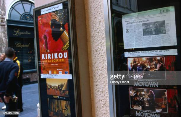 Cinema program and posters at entrance of Cinema Arenberg-Galeries.