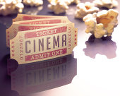 Entry ticket to the cinema with popcorn around.