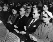 Cinemagoers wearing 3D glasses at a special Festival of Britain three dimensional film screening