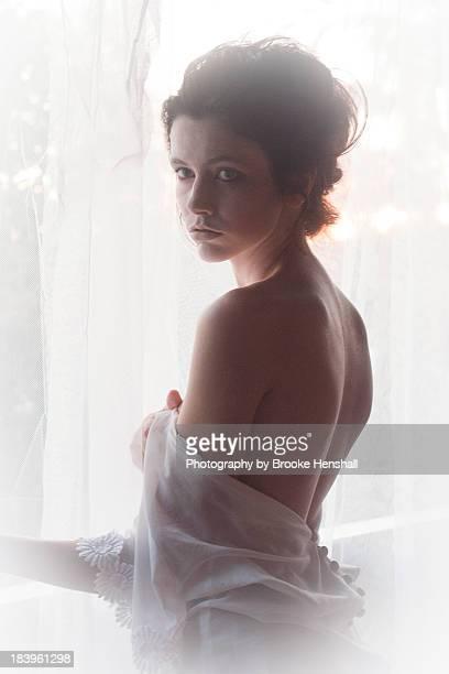 Cinematic portrait girl by window light