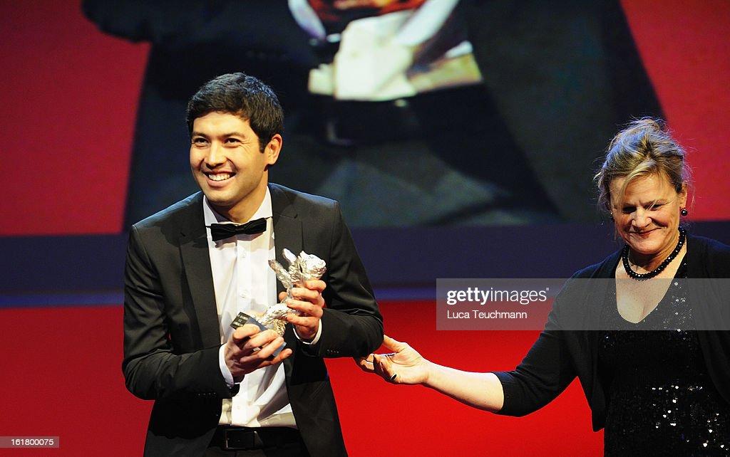 Cinematographer Aziz Zhambakiyev receives the award for best camera by jury member Ellen Kuras at the Closing Ceremony during the 63rd Berlinale...