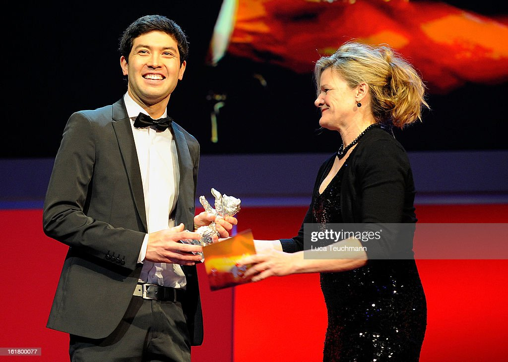 Cinematographer Aziz Zhambakiyev receives the award for best camera by jury member Ellen Kuras at the Closing Ceremony during the 63rd Berlinale International Film Festival at Berlinale Palast on February 14, 2013 in Berlin, Germany.