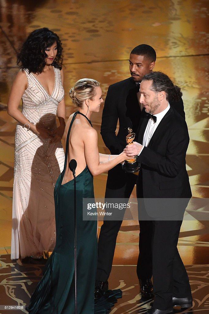 Cinematographer Emmanuel Lubezki accepts the Best Cinematography award for 'The Revenant' from actors Rachel McAdams and Michael B Jordan onstage...