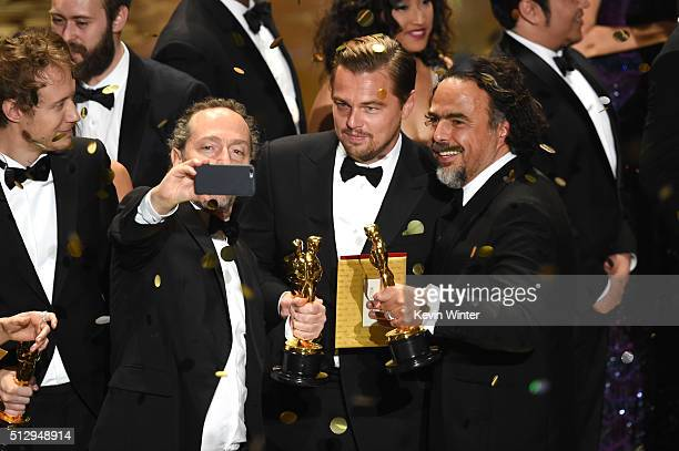 Cinematographer Emmanuel Lubezki actor Leonardo DiCaprio and director Alejandro Gonzalez Inarritu all winners for 'The Revenant' take a selfie...